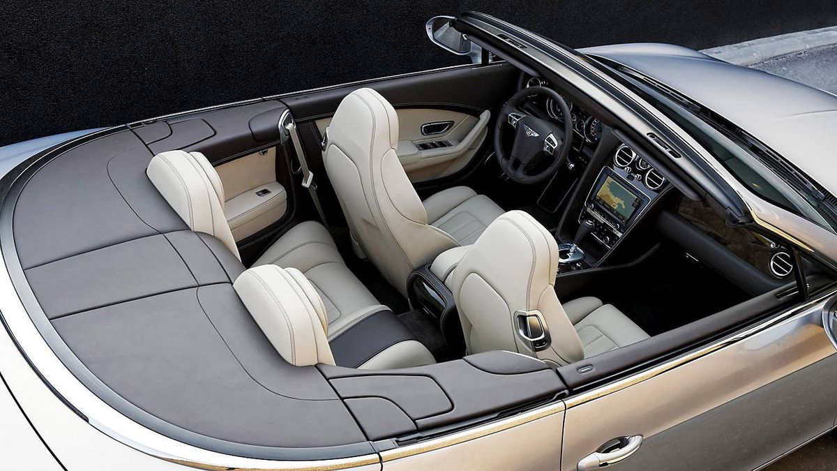 """2012 Bentley Continental GTC in """"extreme silver."""" The vehicle has a top speed of 314 km/hour. It can reach a speed of 100 km/hour in 4.8 seconds. A 2011 Porsche 911 Turbo S ($202,655) will get to 100 km/hour in just over 3 seconds."""