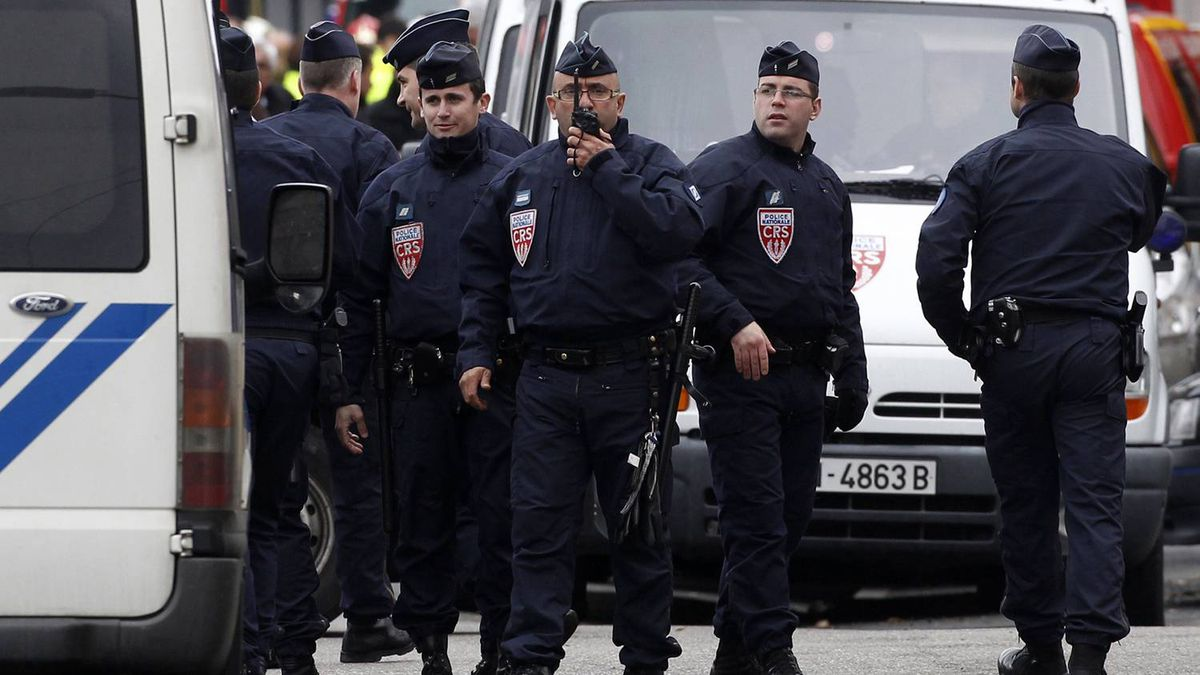 French CRS police block a street during a raid to arrest suspects in the killing of three children and a rabbi on Monday in Toulouse