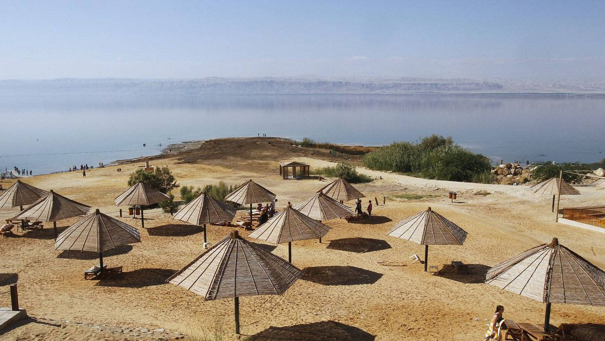 Shelters stand on the beach near the Dead Sea.