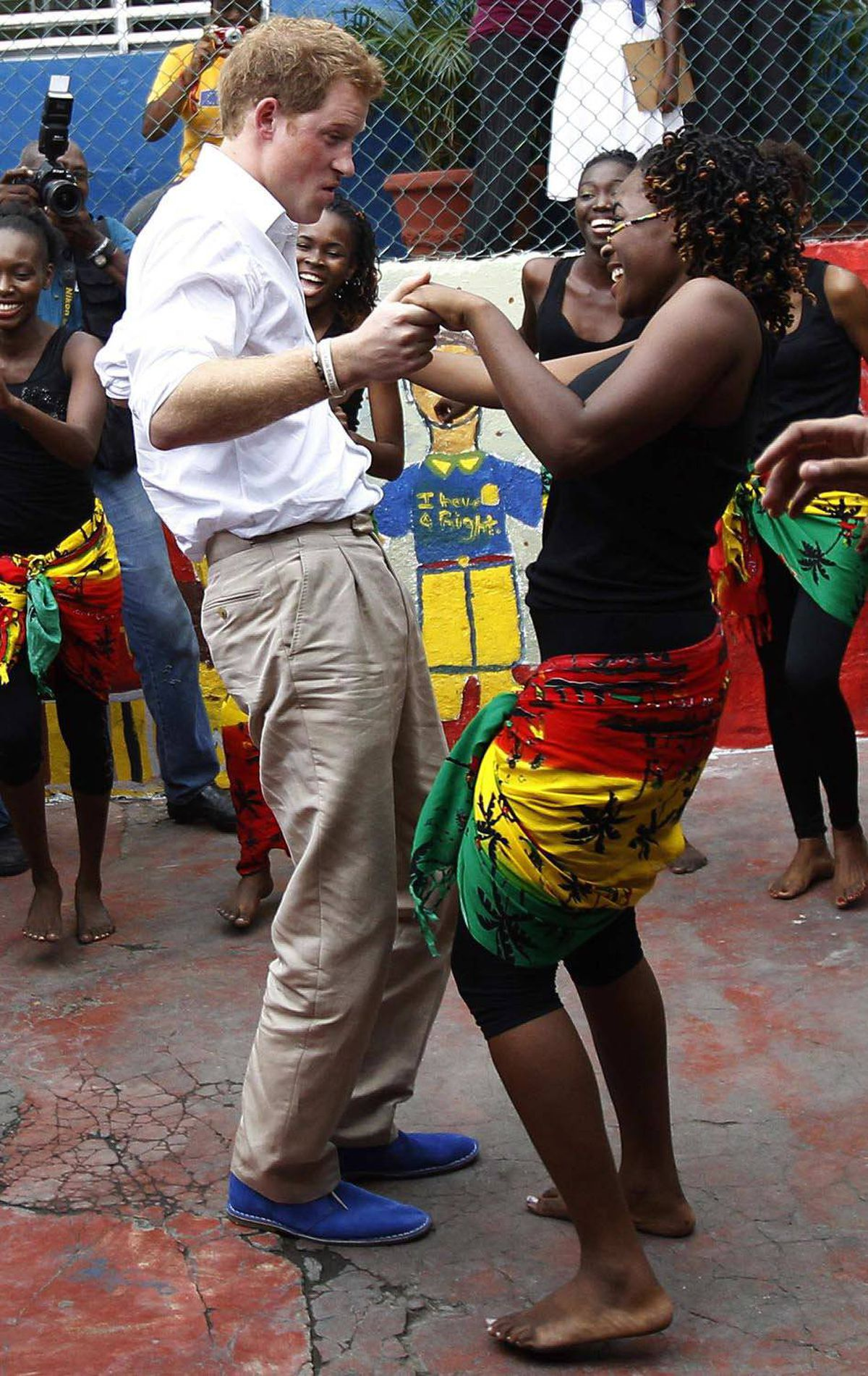 DANCER Britain's Prince Harry dances with Chantol Dormer at a youth community center in Kingston, Jamaica, March 6, 2012.