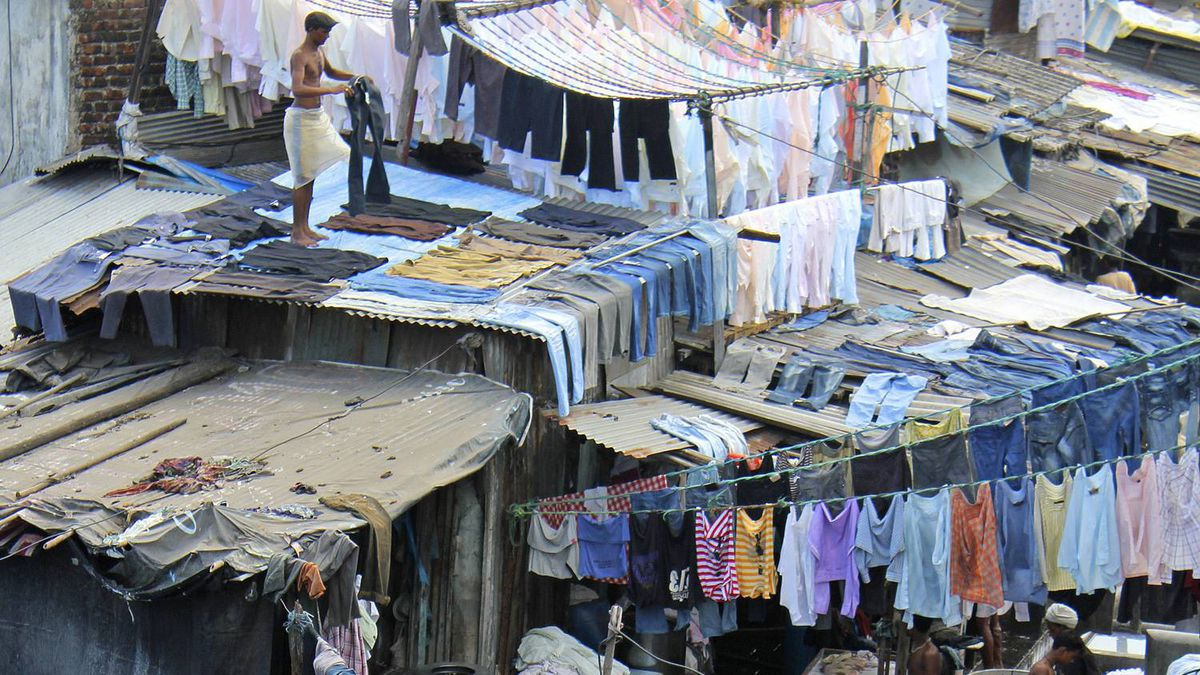 "As the largest open-air laundry in the world, the Dhobi Ghat won Guinness Book fame under the entry ""most people hand-washing clothes simultaneously at a single location"" in March 2011."
