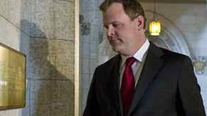 Government House Leader John Baird returns to his office after speaking with reporters in the foyer of the House of Commons on Jan. 24, 2011.