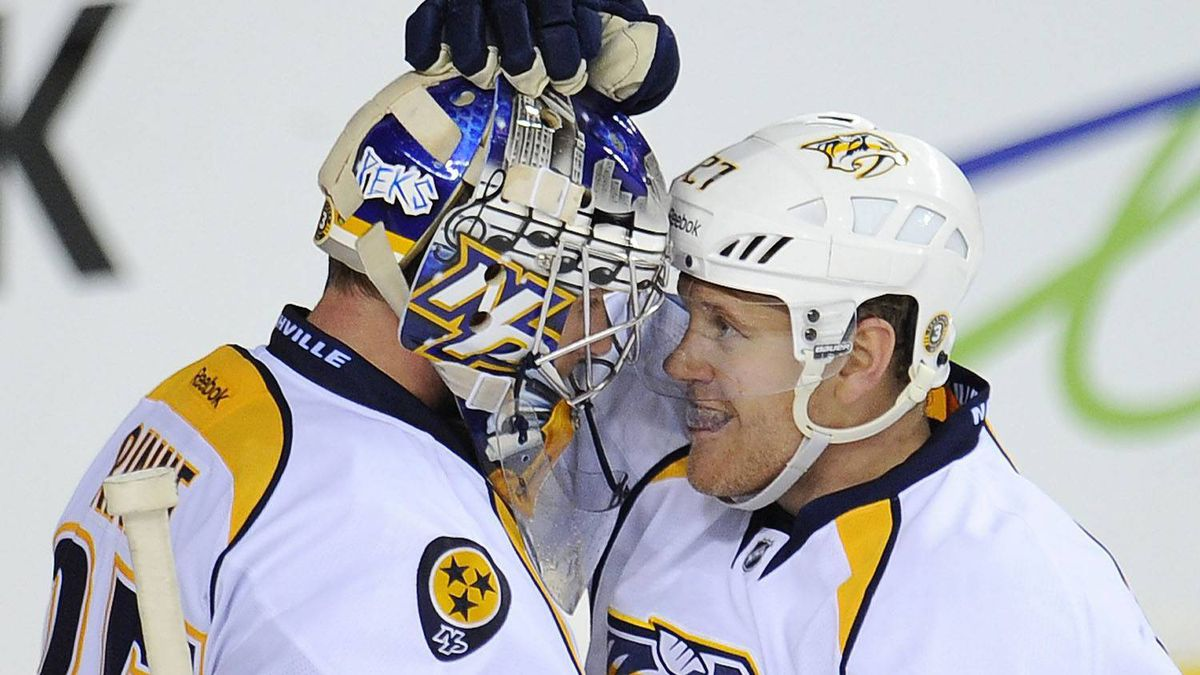 Nashville Predators' Patric Hornqvist, right, from Sweden, congratulates goalie Pekka Rinne, from Finland, on the 2-0 shutout win over the Calgary Flames after NHL action in Calgary, Alta., Saturday Oct. 22, 2011. Rinne stopped 33 shots as the Predators won 2-0 THE CANADIAN PRESS/Larry MacDougal
