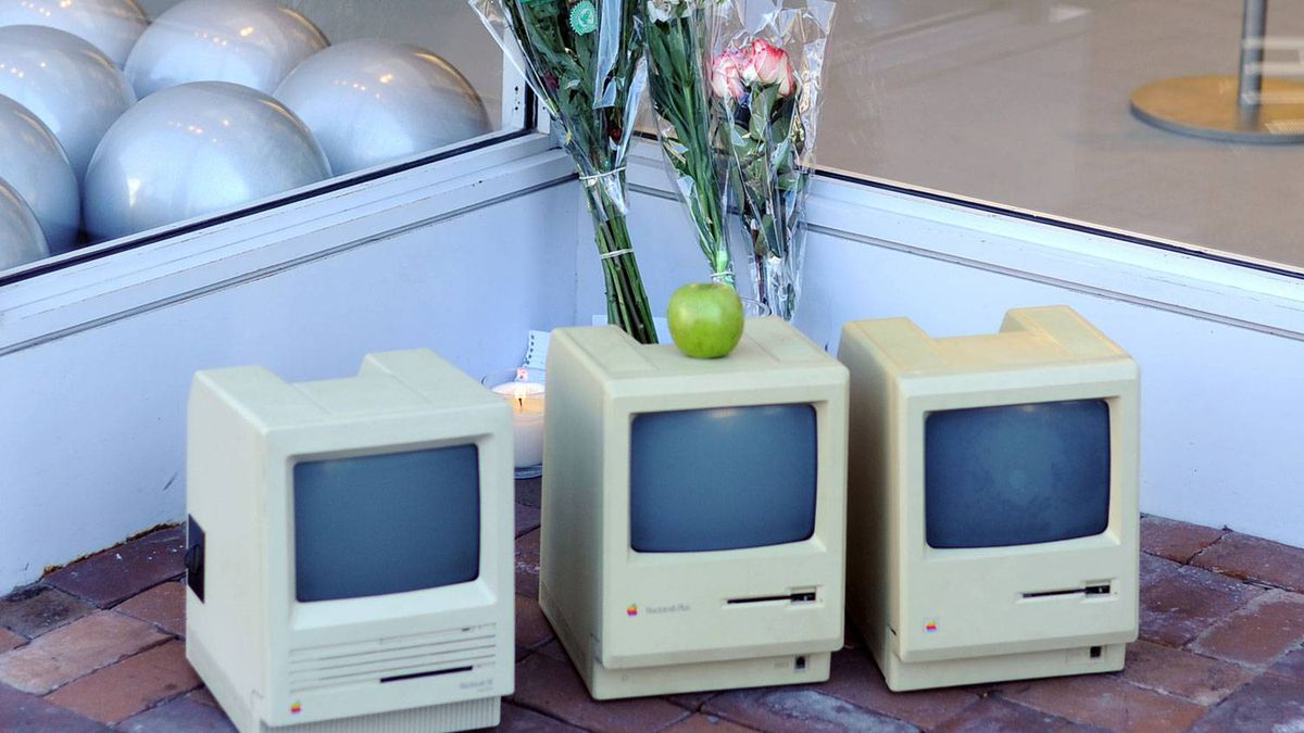 Early Macintosh computers and flowers are placed in front of the Apple Store in Washington on Oct. 6, 2011, one day after Apple co-founder Steve Jobs died at the age of 56 following a long battle with cancer.