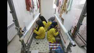 Iranian women weave carpet in a factory in Isfahan, 390 km south of the capital Tehran, Iran Monday, Nov. 14, 2011.