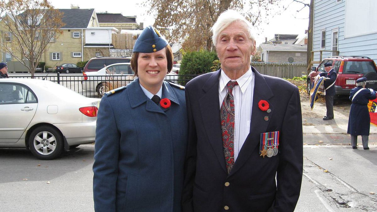 "Kelly Thompson (L) is pictured here with her grandfather at a Remembrance Day ceremony several years ago. Thomspon isn't your typical Canadian military vet, she says: ""I have not been overseas, I have not seen battle, and I have not held the hands of comrades as they died. Instead, I spent my entire career injured and so, I was relegated to a desk."" This will be her first Remembrance Day without uniform after an injury led to her military release."
