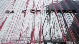 The Bank of Greece building is stained with paint thrown by demonstrators protesting against cutbacks.