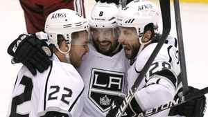 Los Angeles Kings' Trevor Lewis (22), Drew Doughty (8), and Jarret Stoll (28) celebrate a goal by Dwight King against the Phoenix Coyotes in the first period during Game 2 of the NHL hockey Stanley Cup Western Conference finals, Tuesday, May 15, 2012, in Glendale, Ariz.