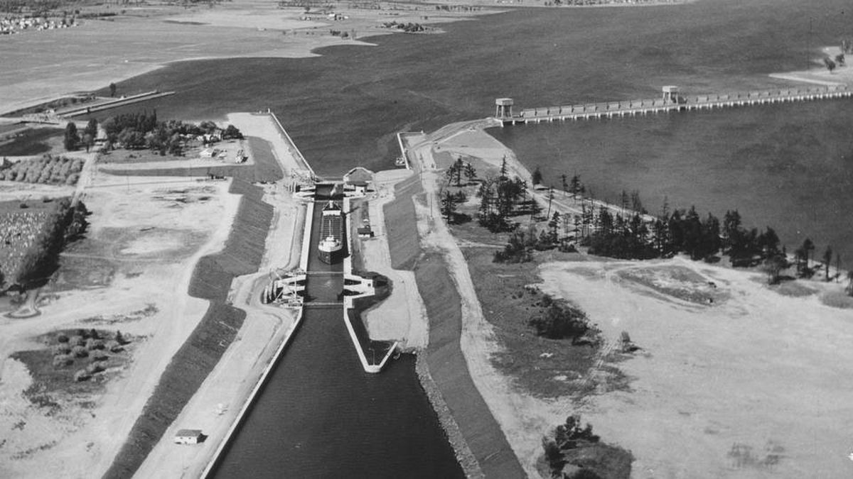 Photographed not long after opening, the most westerly of the seven locks on the St. Lawrence controls traffic between the Thousand Islands and Lake Ontario, whose level is controlled by the Iroquois Dam, shown at right.