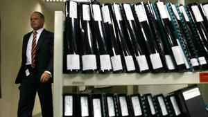 Then-Canadian Security Intelligence Service Assistant Director Jack Hooper walks past stacks of documents in 2005. He wrote a classified November 2005 memo that spells out the spy service's policy on unannounced workplace visits/