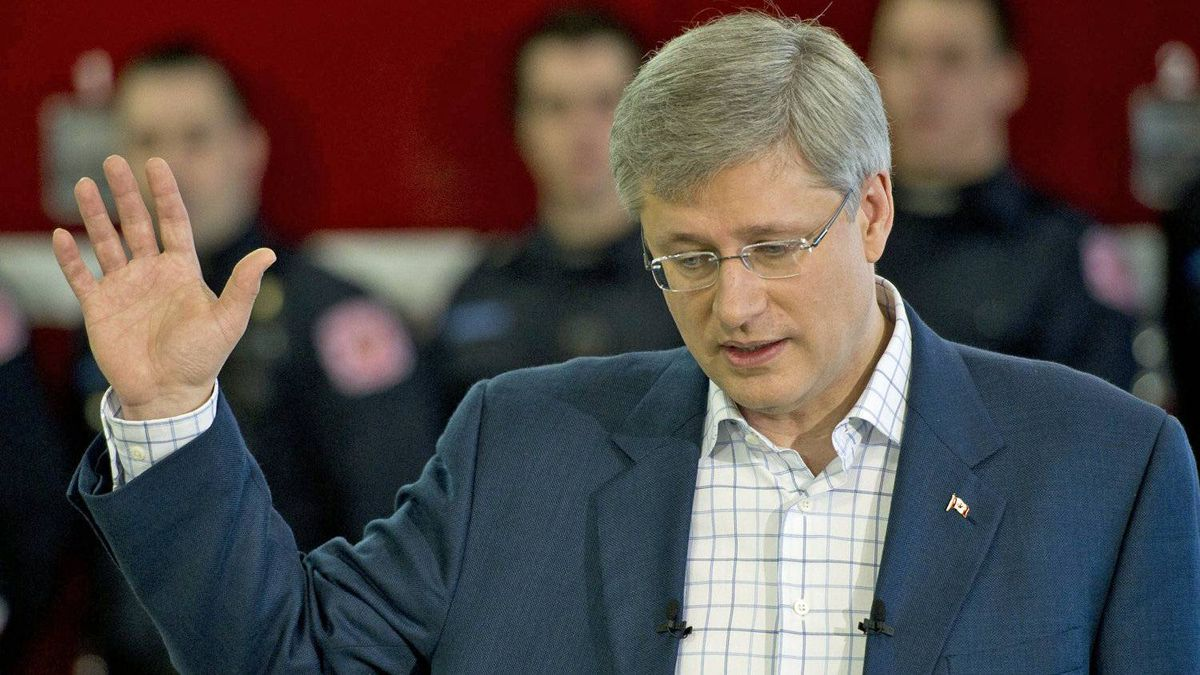 Prime Minister Stephen Harper takes questions during a campaign stop at a firehall in Victoriaville, Que., on April 5, 2011.