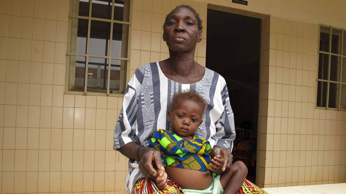 Aissata Bamogo and her 16-month-old granddaughter, Assama Bamogo, who has been admitted to hospital twice in the past four months because of malnutrition. The grandmother says she is heartbroken because she doesn't have enough food for her family, due to the Sahel drought, a failed harvest and a doubling of food prices.