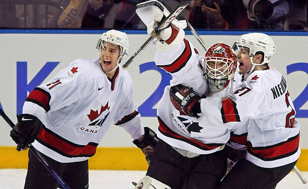 Canadian goalie Martin Brodeur, centre, celebrates with teammates Simon Gagne, left, and Scott Niedermayer following the Men's Gold Medal Ice Hockey victory over the U.S. at the Winter Olympics in Salt Lake City, Utah.