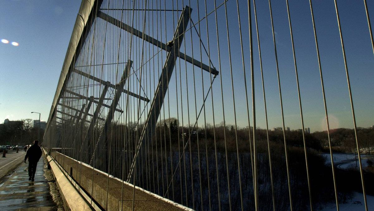 """Construction on the """"Luminous Veil"""", a suicide barrier added to the Prince Edward Viaduct, was completed in 2003."""
