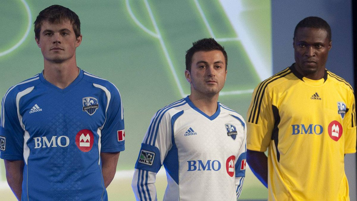 Montreal Impact players Josh Gardner, Sinisa Ubiparipovic, center, and goal keeper Donavan Ricketts model their new jersey at a press conference Thursday, December 1, 2011 in Montreal. The Impact will play in the MLS in the 2012 season.