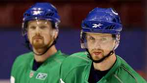 Vancouver Canucks forwards Henrik Sedin, right, and his twin brother, Daniel are two of the most attractive free agents available.