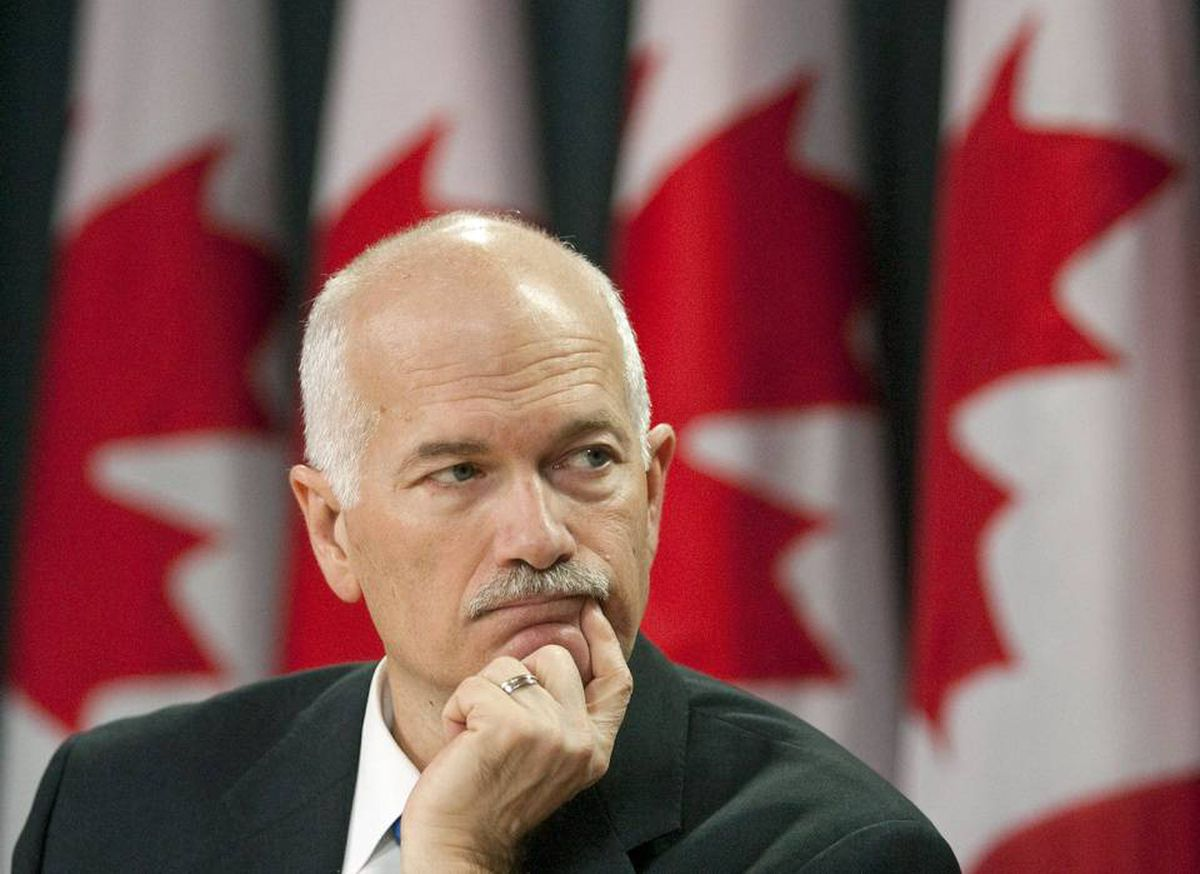 NDP Leader Jack Layton listens during a press conference in Ottawa.