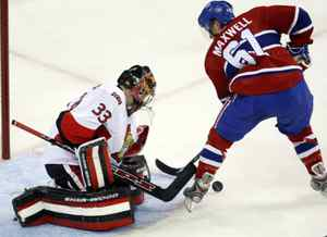 Montreal Canadiens' Ben Maxwell shoots on Ottawa Senators goalie Pascal Leclaire during first period NHL preseason hockey action Friday, September 18, 2009 in Montreal. THE CANADIAN PRESS/Ryan Remiorz