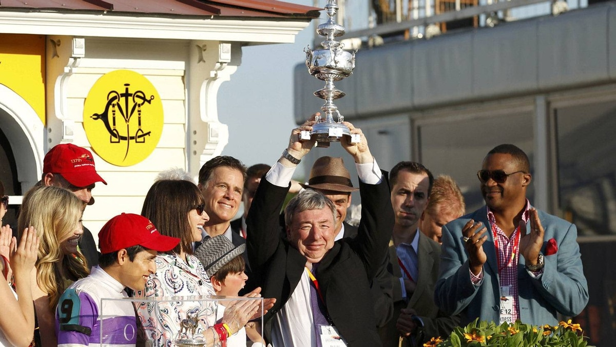 Paul Reddam, owner of I'll Have Another holds the Woodlawn Vase after he won the 137th running of the Preakness Stakes at Pimlico Race Course in Baltimore, Maryland May 19, 2012. REUTERS/Kevin Lamarque