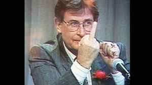 Mr. Klein, then Alberta environment minister, returns a rude gesture to a protester during an announcement about a pulp mill, in December 1990.
