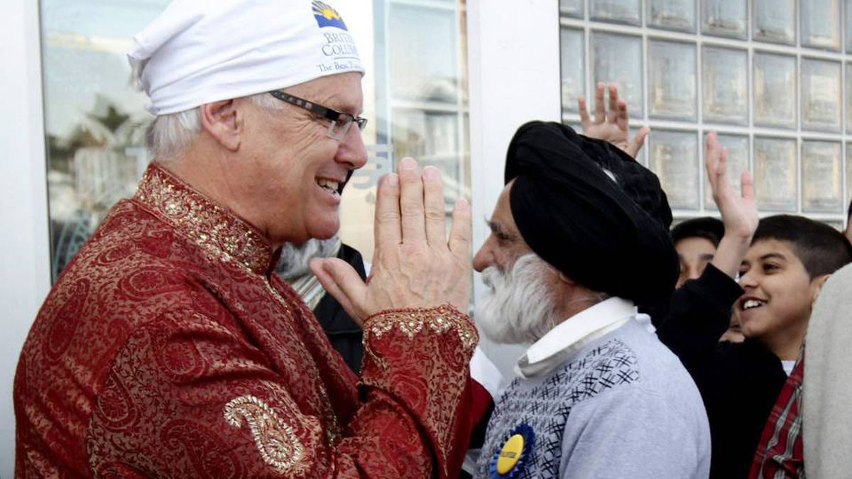 British Columbia Premier Gordon Campbell, left, greets people while attending the Vaisakhi parade in Vancouver, B.C., on Saturday April 10, 2010.