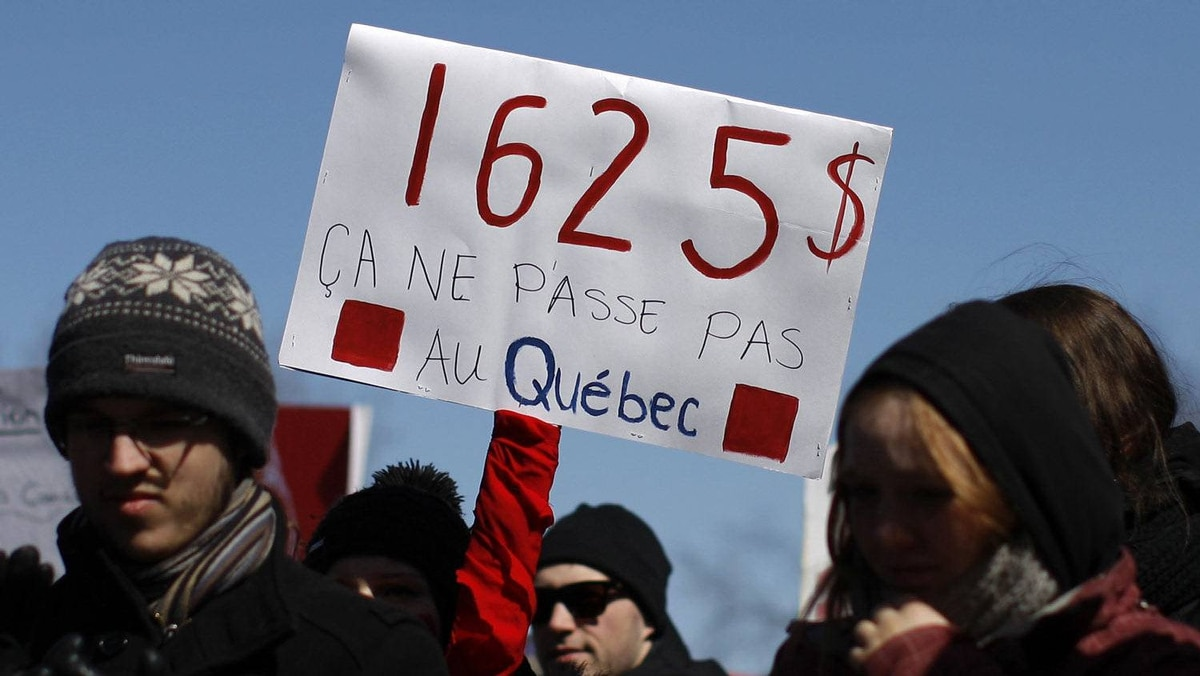 "University and CEGEP students demonstrate against a hike in tuition fees in front of the National Assembly in Quebec City, March 27, 2012. The sign reads: ""$1,625 It doesn't pass in Quebec""."
