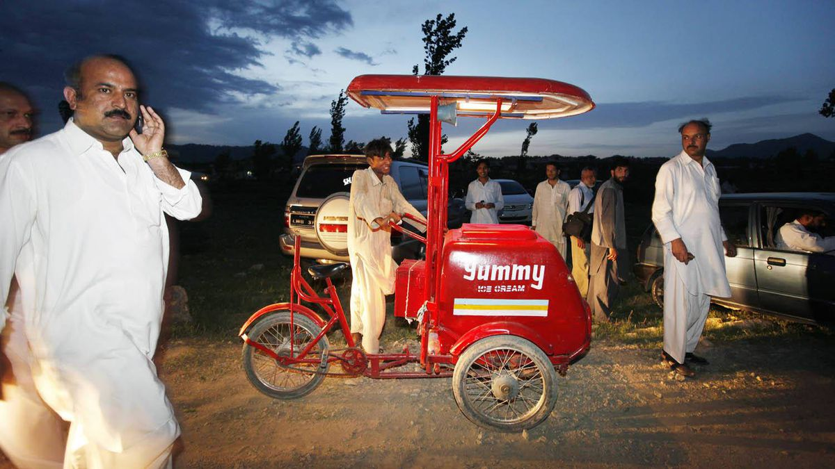 A food vendor sets up shop near the former home of Osama bin Laden near Abbottabad, Pakistan. Since the death of bin Laden, the area has become a tourist attraction in Pakistan.