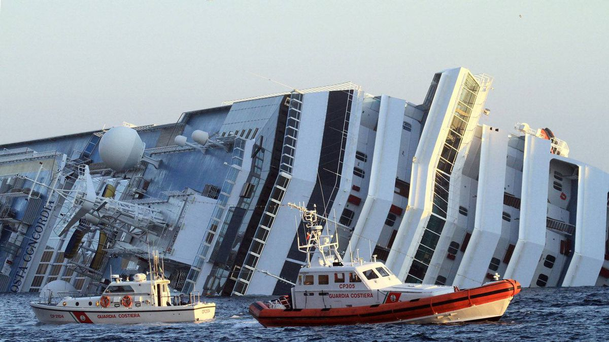 The luxury cruise ship Costa Concordia leans on its side as after running aground off the tiny Tuscan island of Giglio, Italy, Saturday, Jan. 14, 2012. The luxury cruise ship ran aground off the coast of Tuscany, sending water pouring in through a 160-foot (50-meter) gash in the hull and forcing the evacuation of some 4,200 people from the listing vessel early Saturday, the Italian coast guard said.