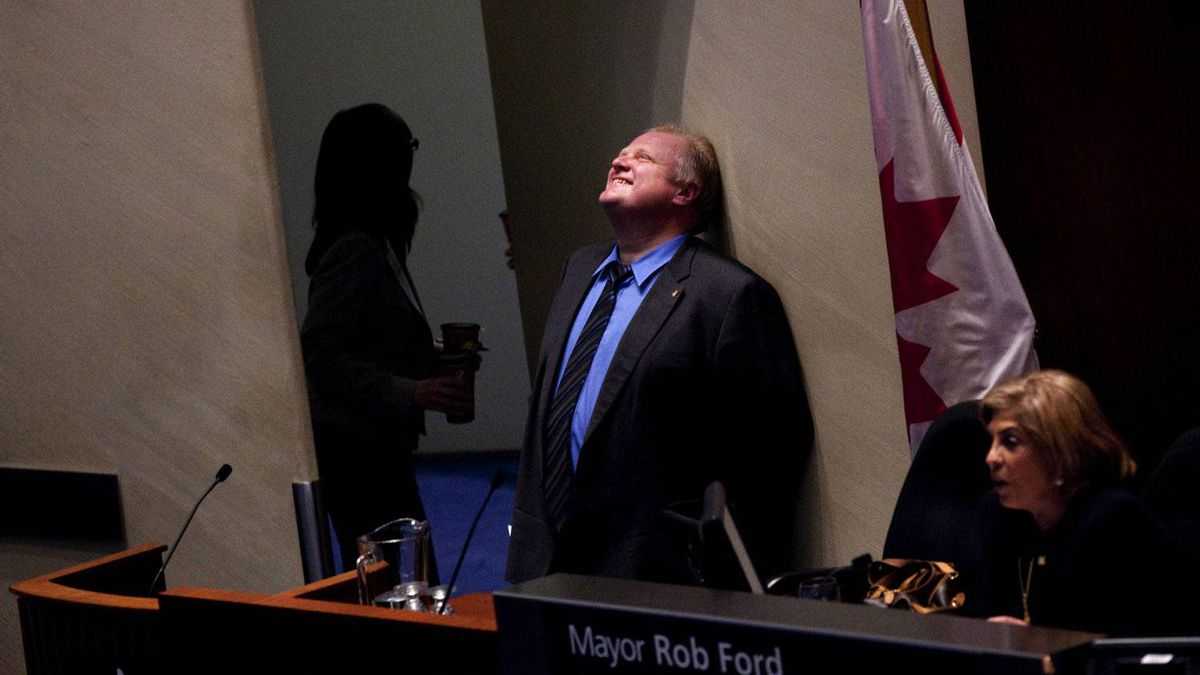 Mayor Rob Ford enjoys a moment after a council vote in March on the hotly contested light rail transit for Sheppard Avenue East.