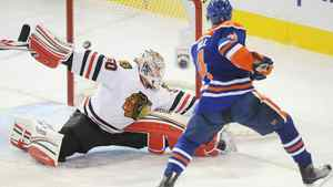 Edmonton Oilers' Taylor Hall scores on Chicago Blackhawks' goalie Corey Crawford during first period NHL hockey action in Edmonton on Saturday, November 19, 2011. THE CANADIAN PRESS/John Ulan