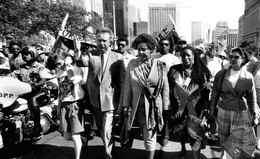Winnie Mandela and then external affairs minister Joe Clark lead a parade up University Avenue from Toronto City Hall June 18, 1990.