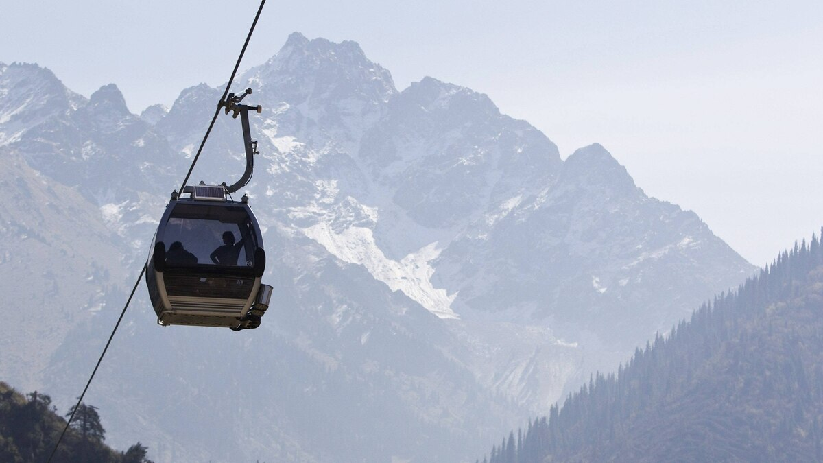 People sit on a cable car in the Tien Shan mountains outside Almaty, Kazakhstan, September 25, 2011.