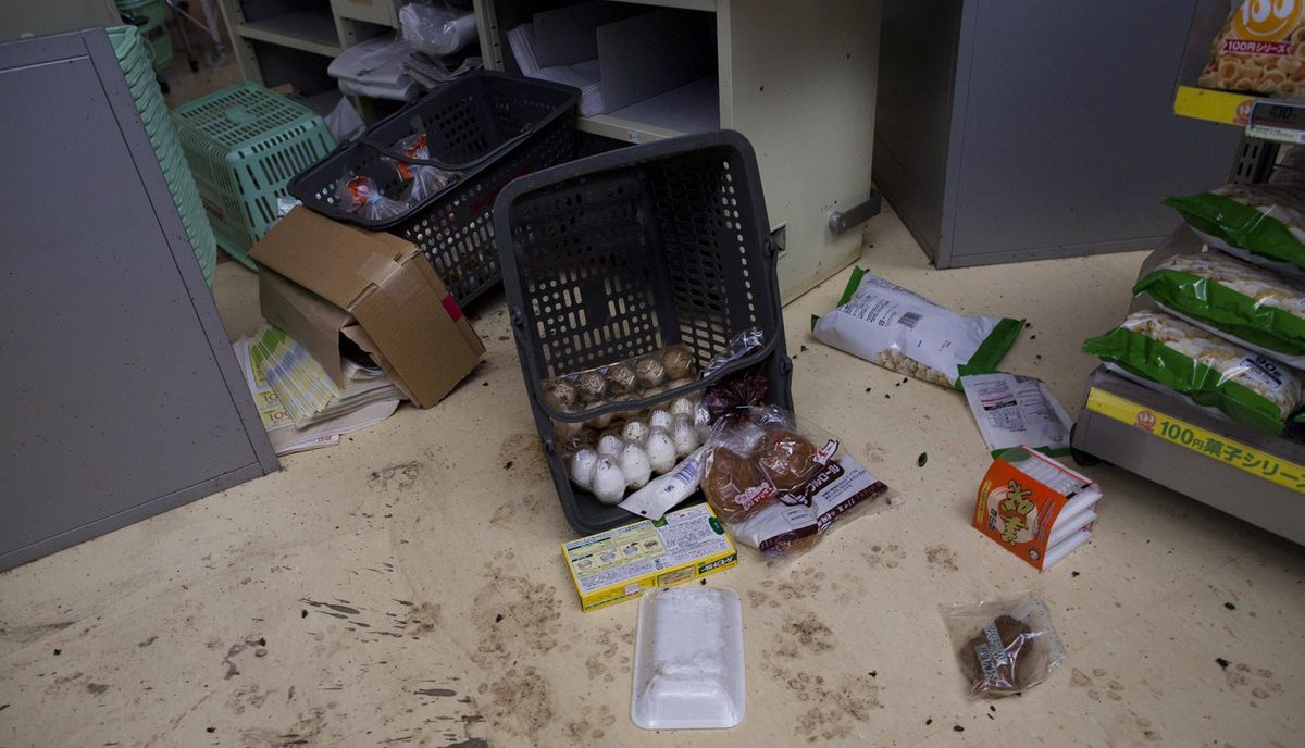 Toppled grocery baskets lay on the floor of an abandoned grocery store in the abandoned town of Namie, inside the 20-kilometer exclusion zone around the Fukushima Daiichi nuclear plant, in northeastern Japan July 26, 2011 . A year after the Tsunami, cleanup has begun, but experts say areas inside the nuclear exclusion zone will be difficult to decontaminate.