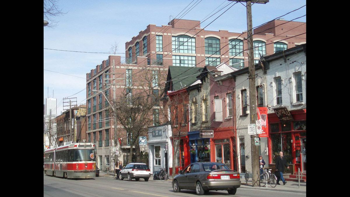 Catherine Anne Wallace photo: Queen West afternoon - Taken May 4 2011, a favourite stretch of Queen W that contrasts old with new, has play of colour, caught a streetcar passing through