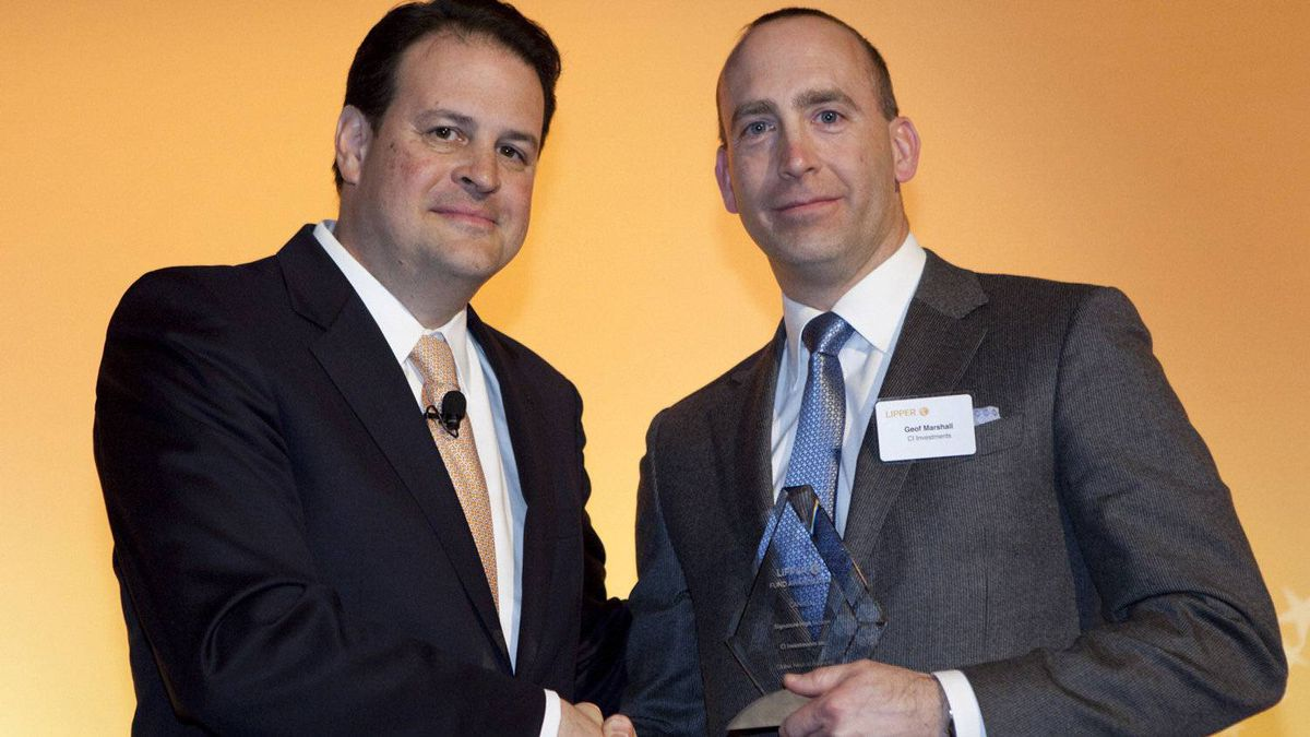 Jim Weber of Thomson Reuters, left, pictured with Geof Marshall of CI Investments, who accepts the award for the Signature High Income fund.