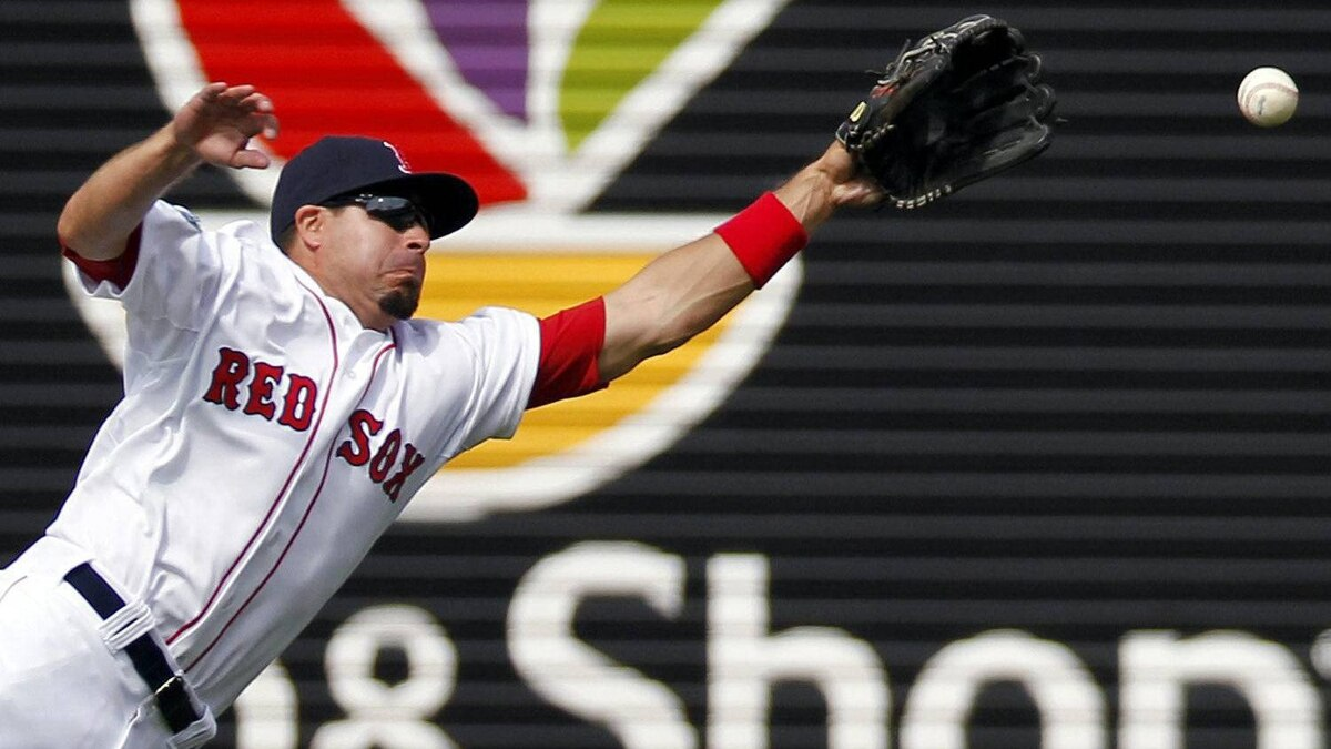 Boston Red Sox center fielder Jason Repko dives for a two-run double hit by Tampa Bay Rays' Carlos Pena in the fifth inning of a baseball game in Boston, Sunday, April 15, 2012. Boston won 6-4. (AP Photo/Michael Dwyer)