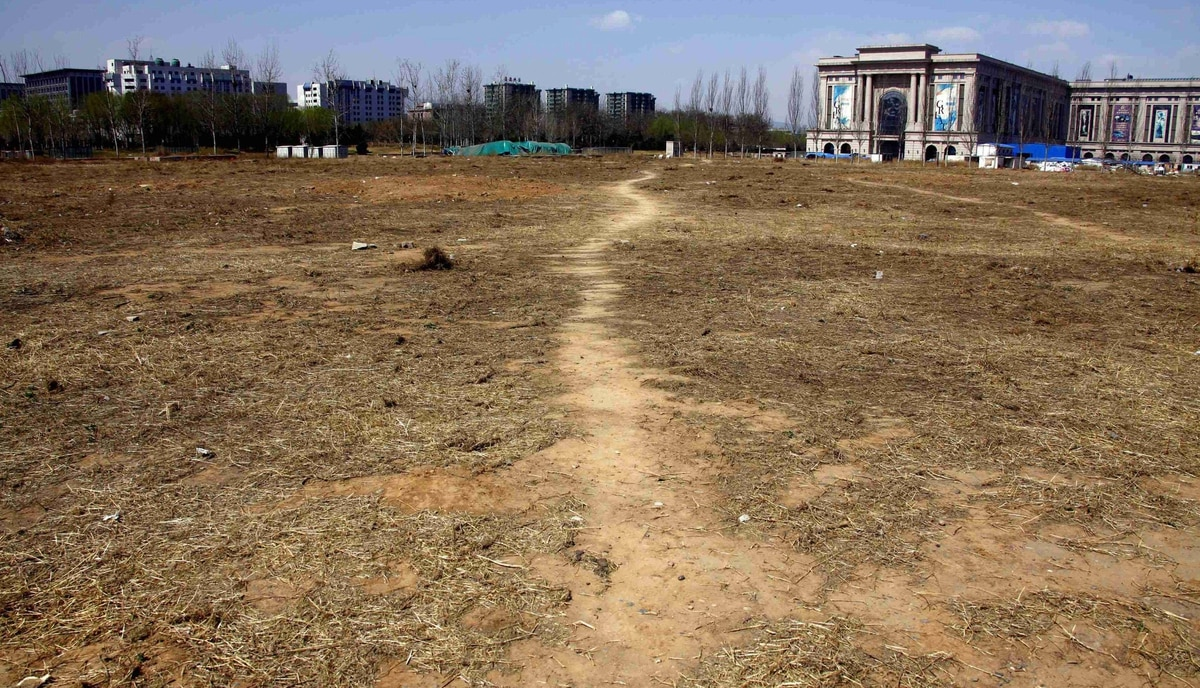 A track leads through a deserted field where the stadium for the 2008 Olympic Games baseball competition once stood in central Beijing March 30, 2012.