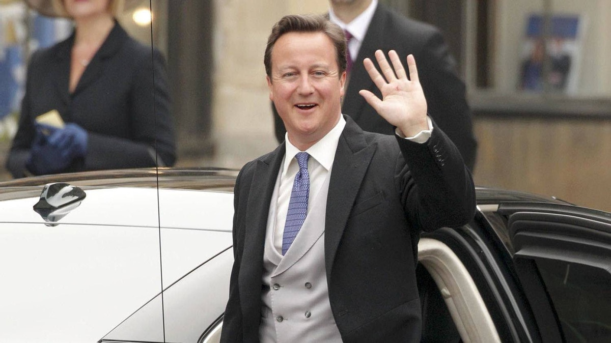 Britain's Prime Minister David Cameron waves as he arrives at Westminster Abbey before the wedding of Britain's Prince William and Kate Middleton, in central London April 29, 2011.