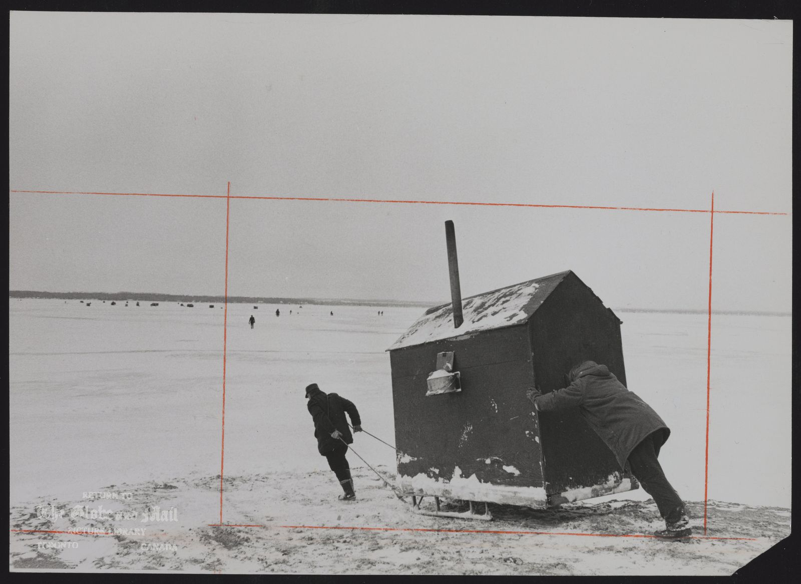 Ice Fishing (Ice hut being hauled by hand since ice is not safe for heavy vehicles,Lake Simcoe at Keswick)
