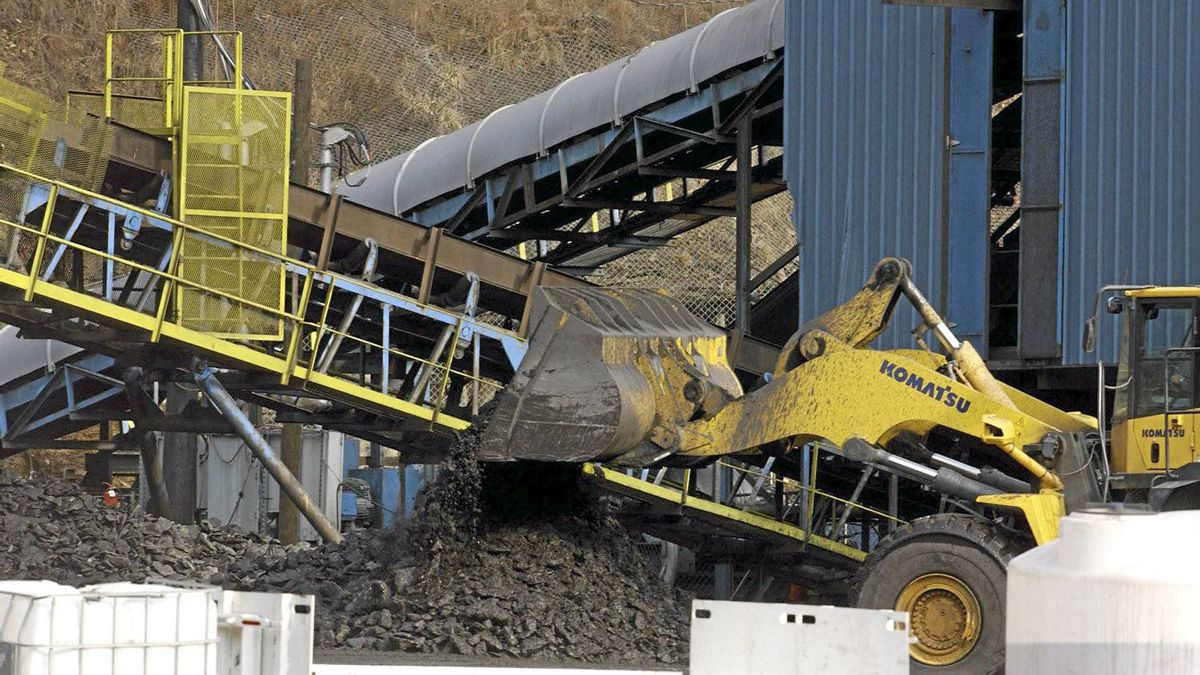 A bulldozer dumps coal at the Brooks Run Mining Co., owned by Alpha Natural Resources, in Cucumber, W.V.