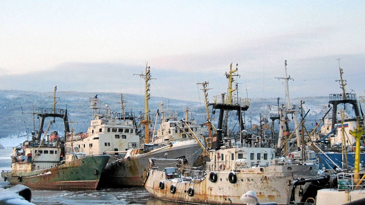 A picture taken 21 February 2006 shows trawlers from the Murmansk fleet in the port, waiting the next fishing expedition.
