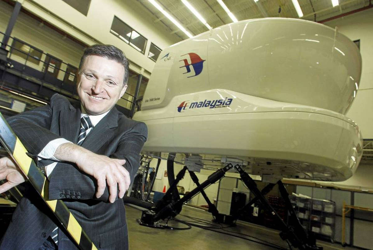 Marc Parent, president and CEO of CAE Inc., poses in front of a flight simulator 737 destined for Malaysia, in Montreal.