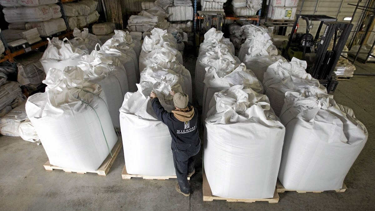 A worker seals one of the totes on the floor that weigh in excess of 1000kg's of lentils that are waiting to be shipped at the Wigmore Farms on Wednesday, Nov. 10, 2010 near Regina, Sask. The farm is approx. 10 kilometres west of Regina.