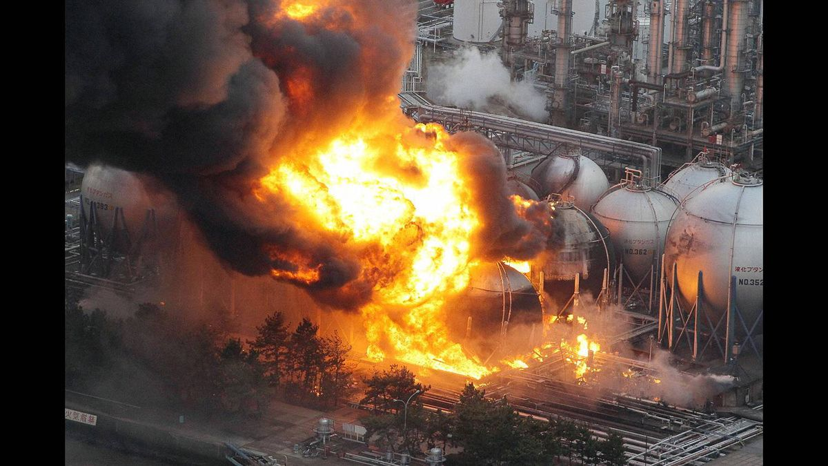 Natural gas storage tanks burn at a facility in Chiba Prefecture, near Tokyo.