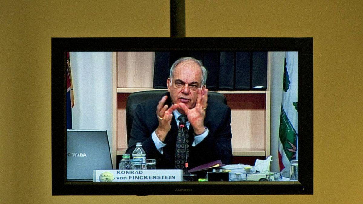 CRTC chairman Konrad von Finckenstein is seen on a TV screen the regulator's hearings in Gatineau, Que., on Nov. 12, 2009.