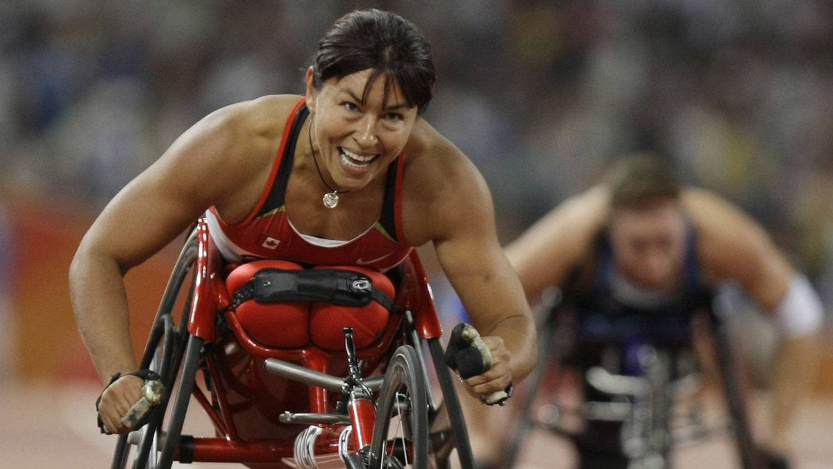 Canada's Chantal Petitclerc smiles after crossing the finish line in the women's 400m T54 final at the Beijing 2008 Paralympic Games September 12, 2008.