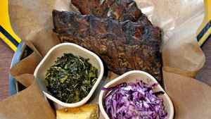 Pork ribs (with corn bread, coleslaw and southern greens) are served at Peckinpah BBQ, 2 Water St., in Vancouver.