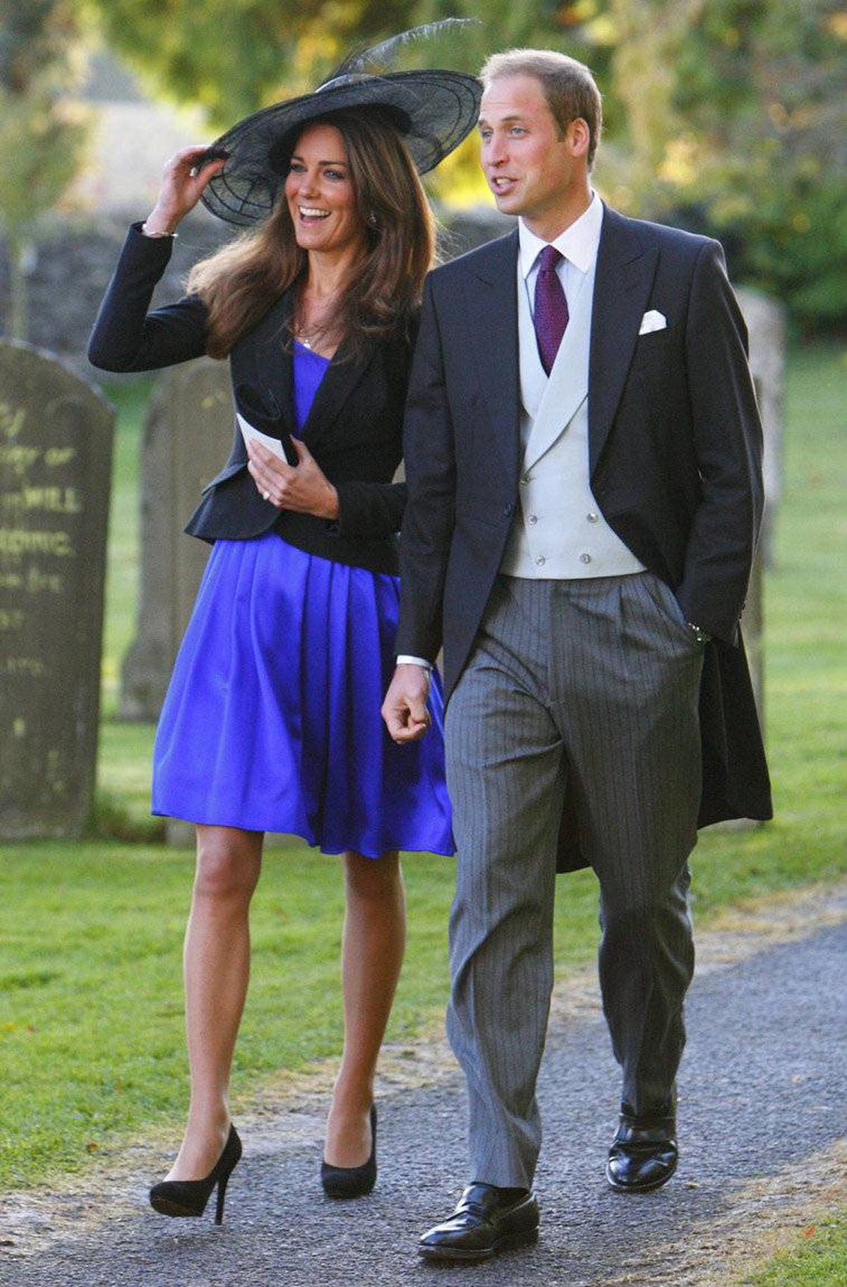 Prince William and Kate Middleton leave the wedding of their friends Harry Mead and Rosie Bradford in the village of Northleach, England.