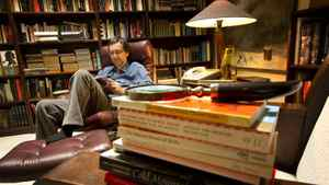 Guy Gavriel Kay reads in his library at his home in Toronto.