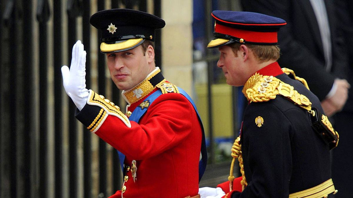 Britain's Prince William (L) waves as he arrives with his brother Prince Harry at the West Door of Westminster Abbey for his wedding, in London on April 29, 2011.